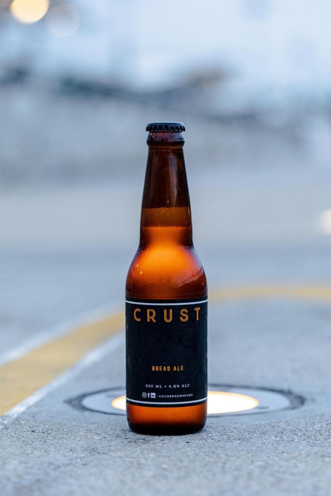今回、日本で発売が決定したのは、売れ残りのパンで製造したCRUSTの代名詞ともいえるクラフトビール「CRUST」に加え、とある余剰食材で製造した炭酸飲料「CROP」をリリース予定(詳細、近日公開予定)。 両商品は2020年12月末~2021年1月の間に正式提供販売を予定しております。